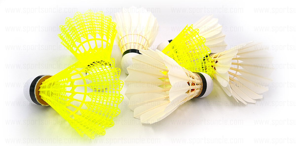 feather and plastic shuttlecock